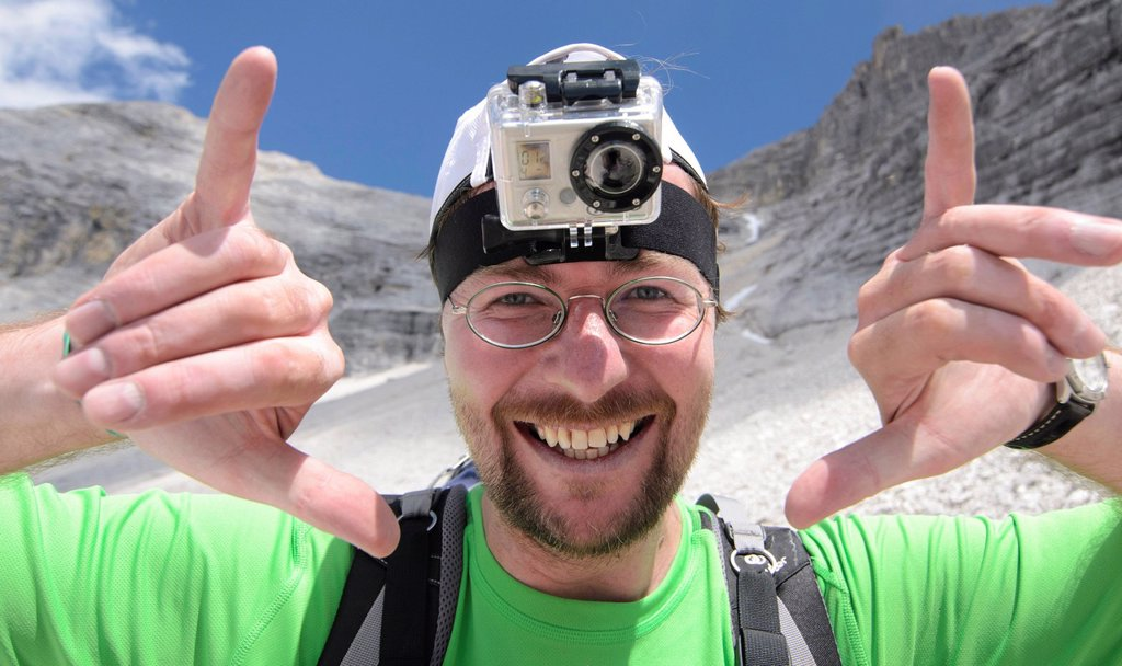 Young man, mountain hiker with a GoPro HD Video Camera mounted to his head, Karwendel Mountains National Park, Tyrol, Austria, Europe : Stock Photo