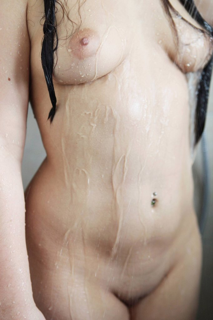 Stock Photo: 1848-657122 Female body, woman taking a shower