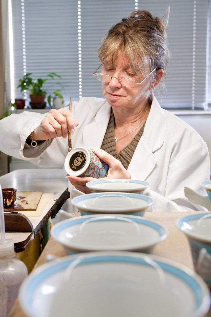 Stock Photo: 1848-657635 Employee painting a Versace teacup at the porcelain manufacturer Rosenthal GmbH, Speichersdorf, Bavaria, Germany, Europe