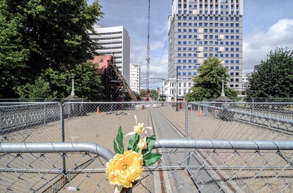 Flowers on a fence, cordoned off town centre in the earthquake zone of Christchurch, South Island, New Zealand : Stock Photo