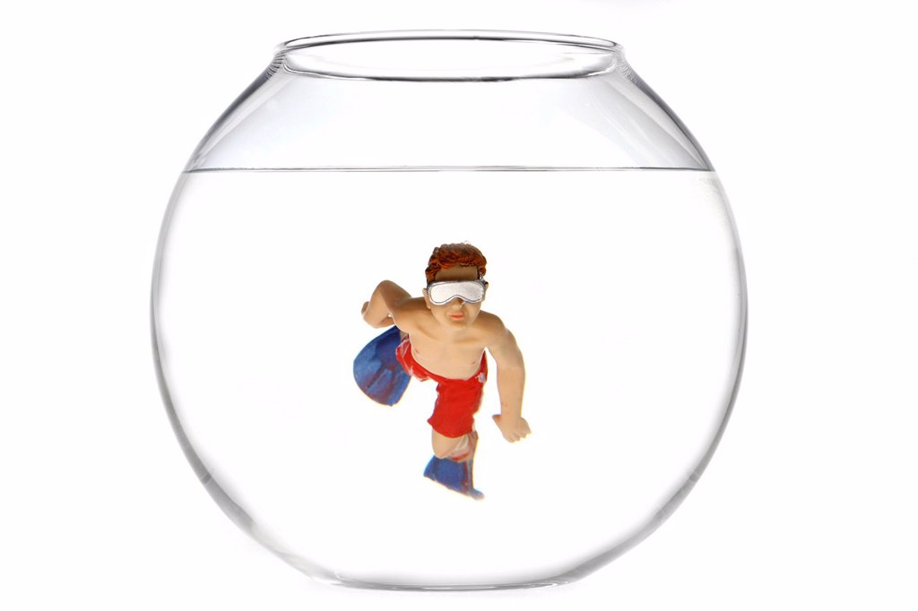 Stock Photo: 1848-660045 Toy boy swimming with diving goggles and flippers in a fish bowl, illustration