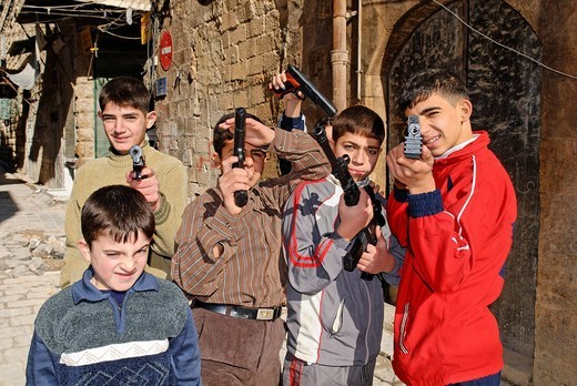 Armed children in Aleppo, Syria : Stock Photo