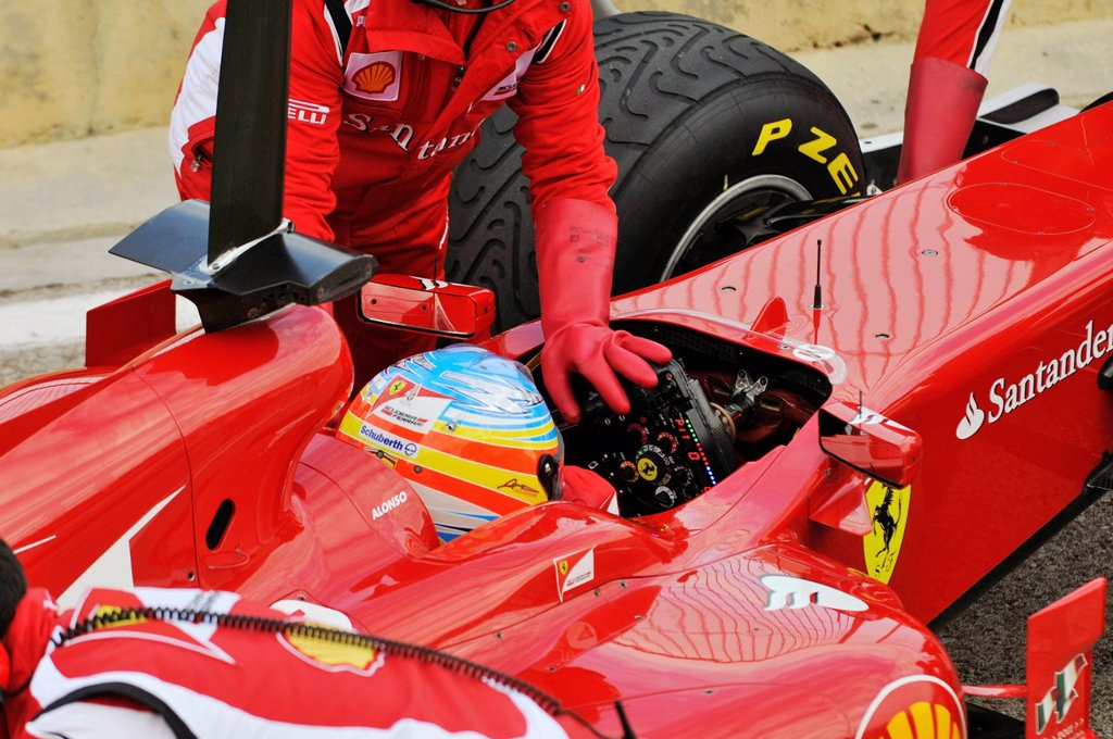 Stock Photo: 1848-661239 Fernando Alonso, ESP, in the cockpit of the Ferrari 150 during the Formula 1 test_drive at the Circuit Ricardo Tormo near Valencia, Spain, Europe