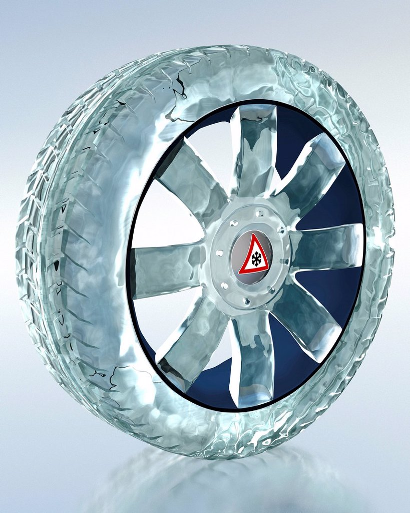 Car tyre made of ice, symbolic image for the mandatory use of winter tyres : Stock Photo