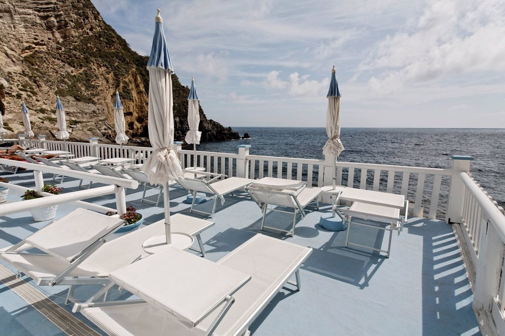 Stock Photo: 1848-662149 Sun terrace with sunloungers, Bay of Sorgeto, near Panza, Forio, Ischia Island, Gulf of Naples, Campania, Southern Italy, Italy, Europe