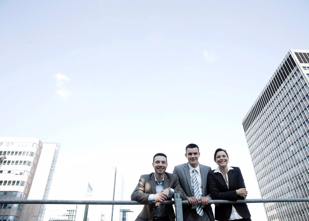 Stock Photo: 1848-662539 Group of business people in front of tall buildings