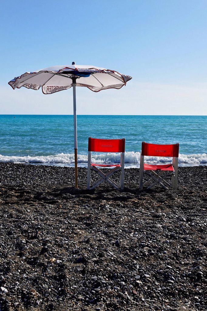 Italian life guard chairs and sun umbrella on beach, Le Gorette, Cecina, Tuscany, Italy, Europe : Stock Photo