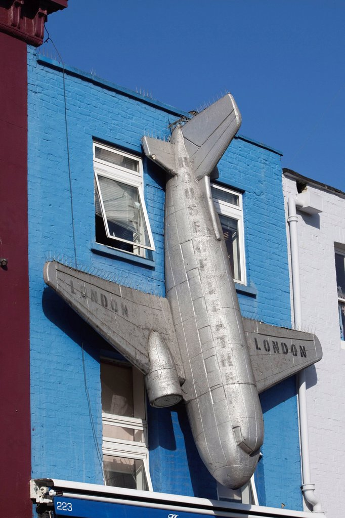 Colourfully decorated facade featuring an aeroplane at Camden Market, Camden Town, London, England, United Kingdom, Europe : Stock Photo