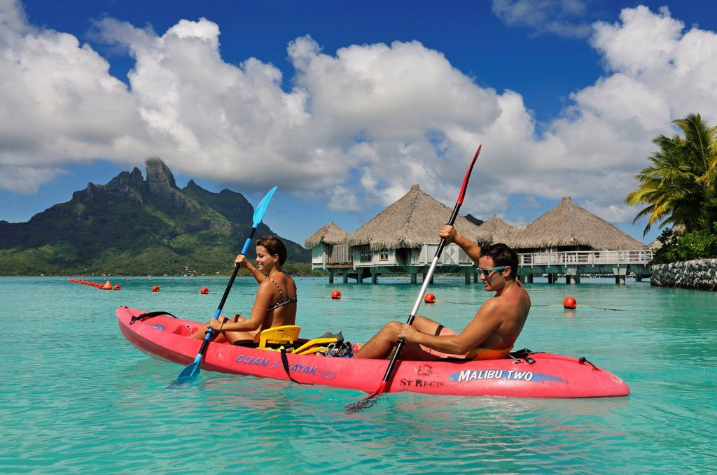 Tourists in a kayak, St. Regis Bora Bora Resort, Bora Bora, Leeward Islands, Society Islands, French Polynesia, Pacific Ocean : Stock Photo