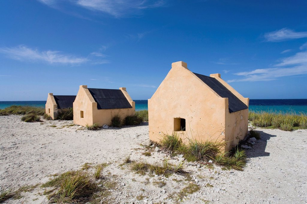 Slave huts near Pekelmeer, former accommodation for slaves who worked in the salt pans of Bonaire, Lesser Antilles, former Netherlands Antilles, Caribbean : Stock Photo