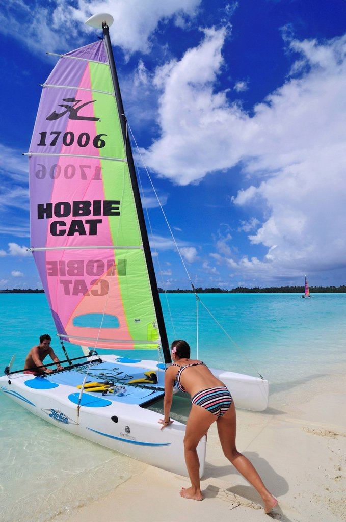 Stock Photo: 1848-666280 Tourists sliding catamaran into the sea, St. Regis Bora Bora Resort, Bora Bora, Leeward Islands, Society Islands, French Polynesia, Pacific Ocean