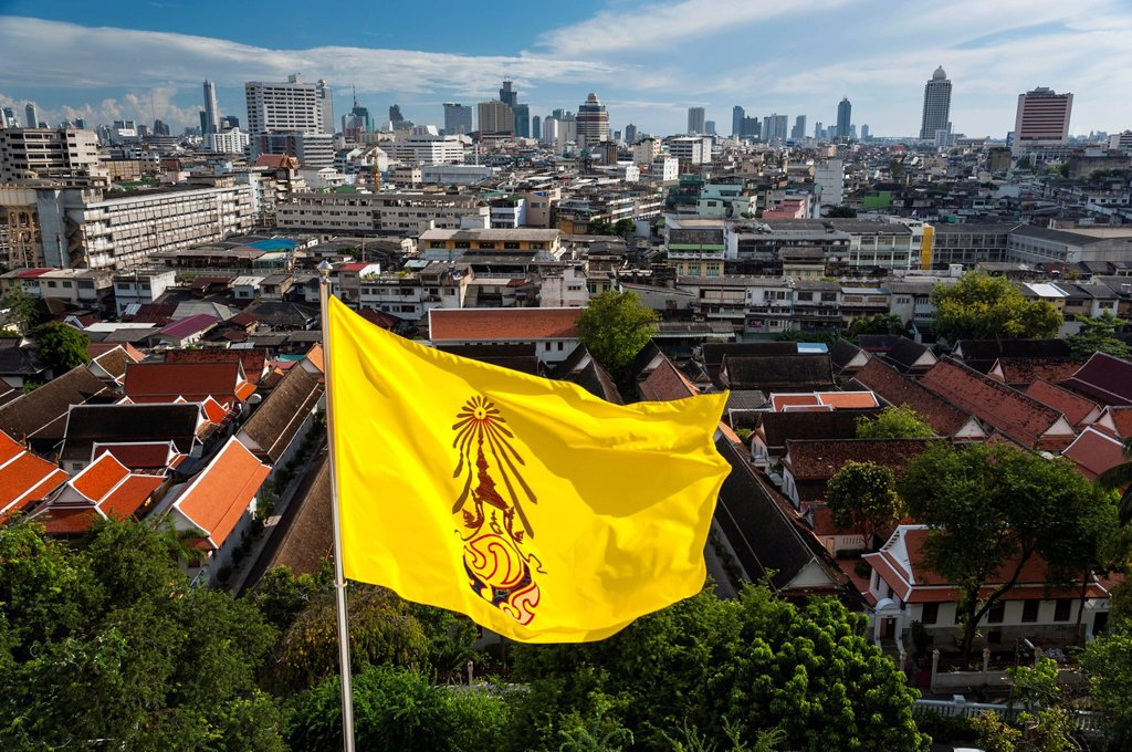 Yellow flag, view of the Bangkok skyline with the Bang Rak financial district, Bangkok, Thailand, Asia : Stock Photo