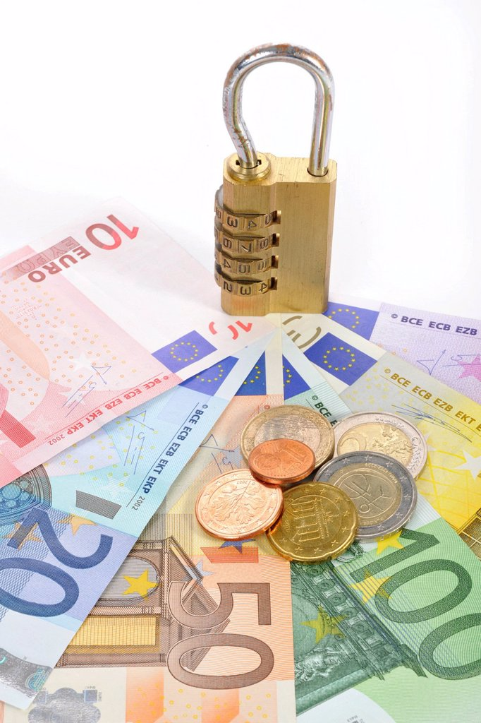 Stock Photo: 1848-668044 Combination lock on euro banknotes and coins, symbolic image of monetary security