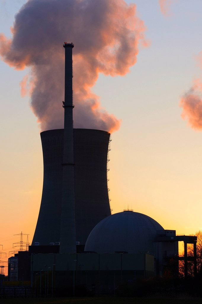 Grafenrheinfeld nuclear power plant operated by E.ON, silhouetted at dusk, Schweinfurt, Bavaria, Germany, Europe : Stock Photo
