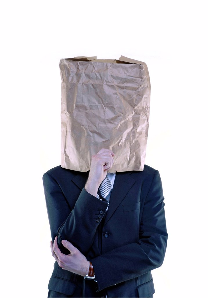 Stock Photo: 1848-668183 Thoughtful businessman with paper bag over his head