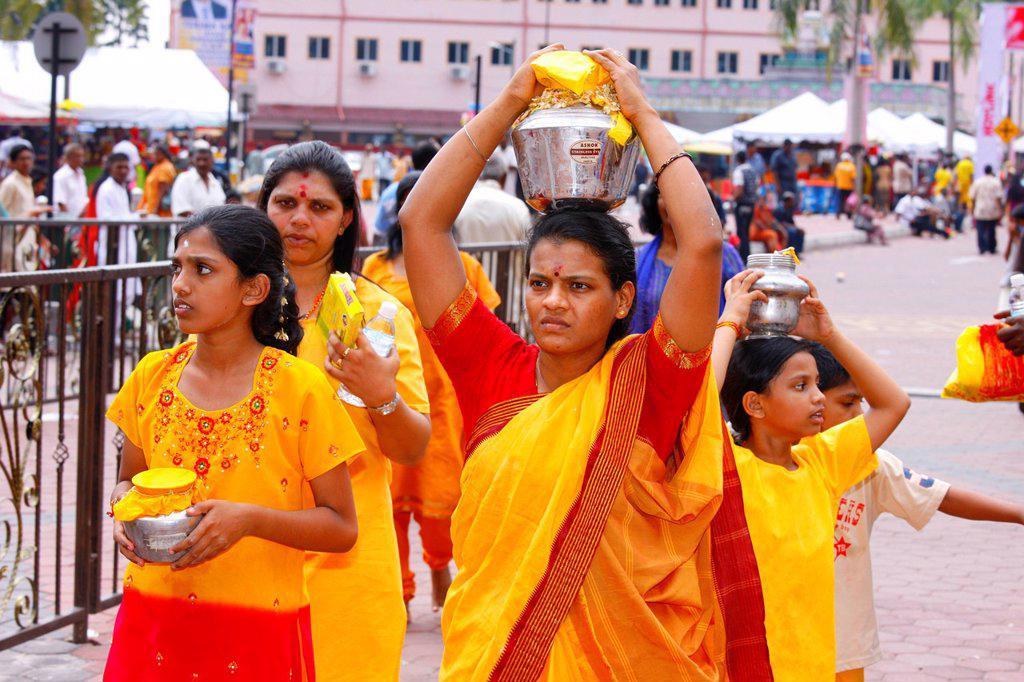 Pilgrims making a milk sacrifice, Hindu festival Thaipusam, Batu Caves limestone caves and temples, Kuala Lumpur, Malaysia, Southeast Asia, Asia : Stock Photo