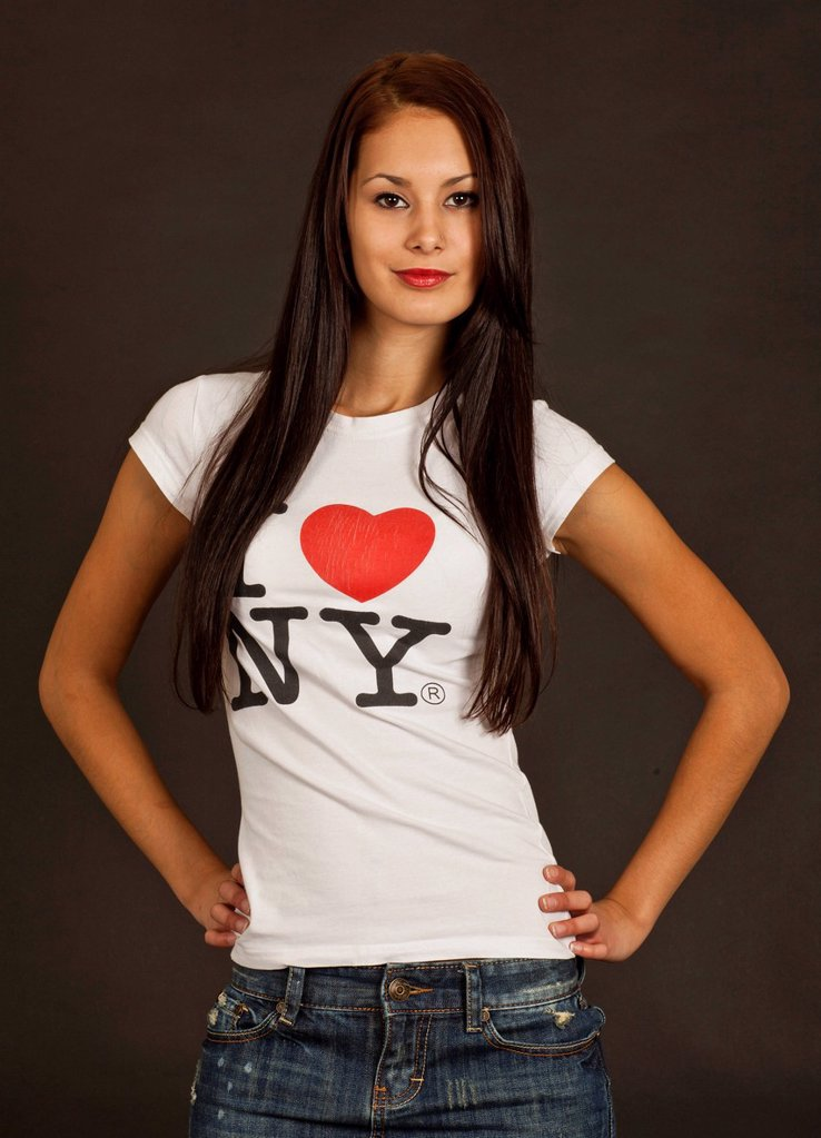 Stock Photo: 1848-669719 Self_confident young woman posing in a white T_shirt, lettering ´´I love NY´´
