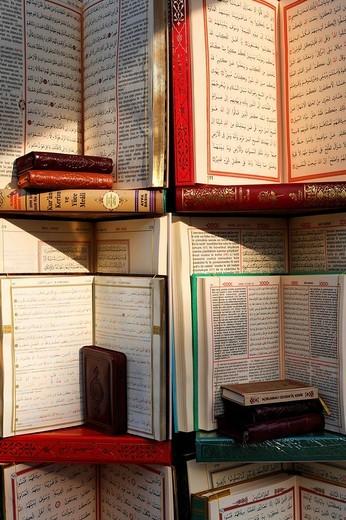 Bilingual Koran, suras in Arabic and Turkish, Islamic Bookstore, Muslim village golden horn at Eyuep, Istanbul, Turkey : Stock Photo