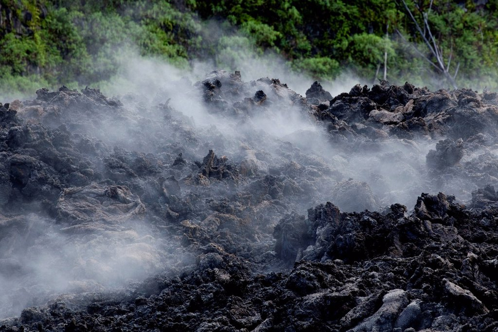 Still warm lava from an eruption of the volcano Piton de la Fournaise in 2007 steaming after rain, at Piton Sainte_Rose, Reunion island, Indian Ocean : Stock Photo