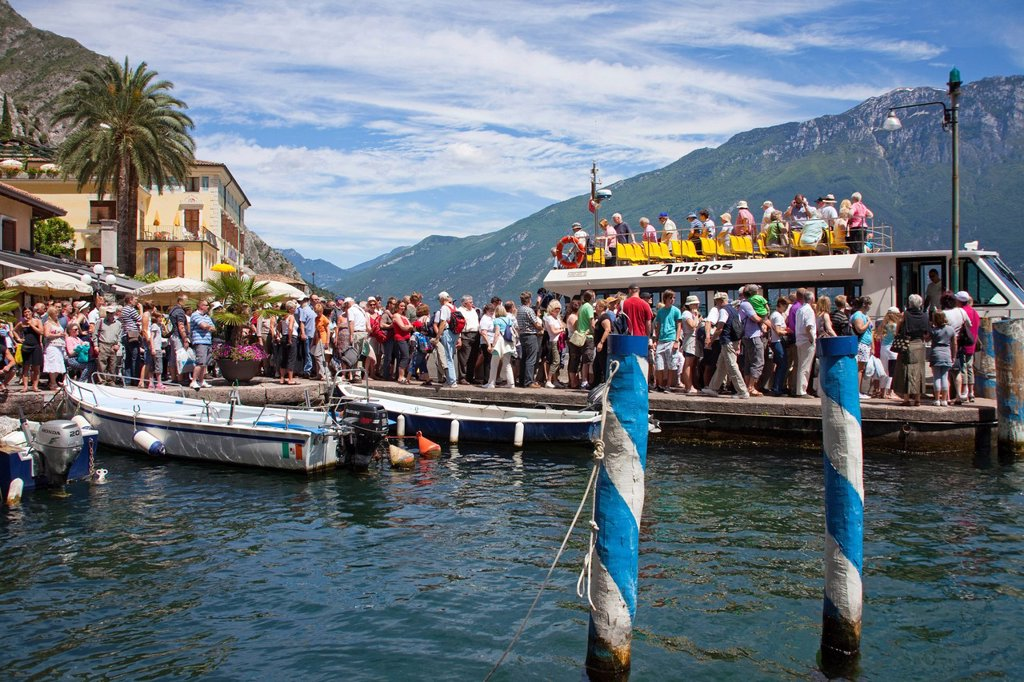 Stock Photo: 1848-671105 Tourists getting on the ferry, pier, traditional blue and white posts, Limone sul Garda, Lake Garda, province of Brescia, Lombardy region, Italy, Europe