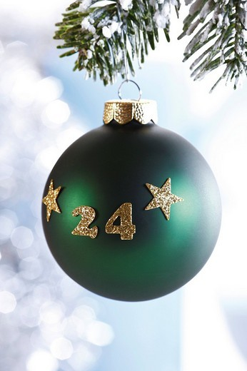 Stock Photo: 1848-67120 Green Christmas ball 24 hanging from fir branch, symbolic picture for Christmas eve