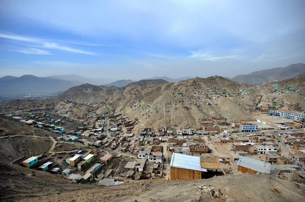 Houses built on sandy slopes in the dry desert climate, slums of Amauta, Lima, Peru, South America : Stock Photo