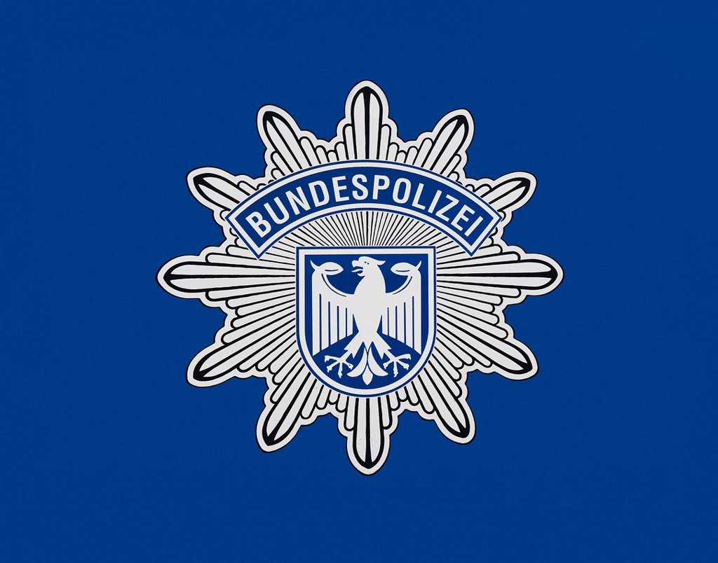 Coat of arms of the Federal Police on blue : Stock Photo
