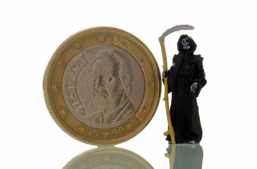 Death is standing next to a Spanish euro coin, symbolic image for the crisis of the euro : Stock Photo