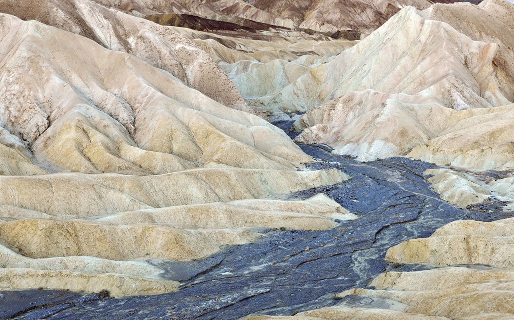 View from Zabriskie Point towards eroded rock formations discoloured by minerals, dawn, Death Valley National Park, Mojave Desert, California, United States of America, USA : Stock Photo