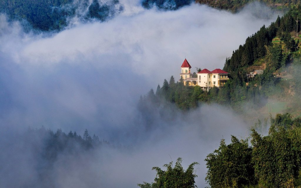 Villa in the early morning with cloud sea in the mountains in Sapa or Sa Pa, Lao Cai province, northern Vietnam, Vietnam, Southeast Asia, Asia : Stock Photo
