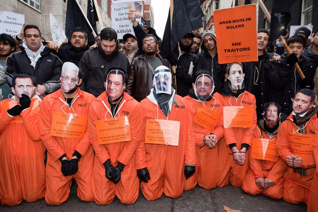 Stock Photo: 1848-677215 Anti_Mubarak Protest, pro_Sharia law supporters wearing orange Guantanamo Bay_style overalls and masks of Arab leaders, London, England, United Kingdom, Europe