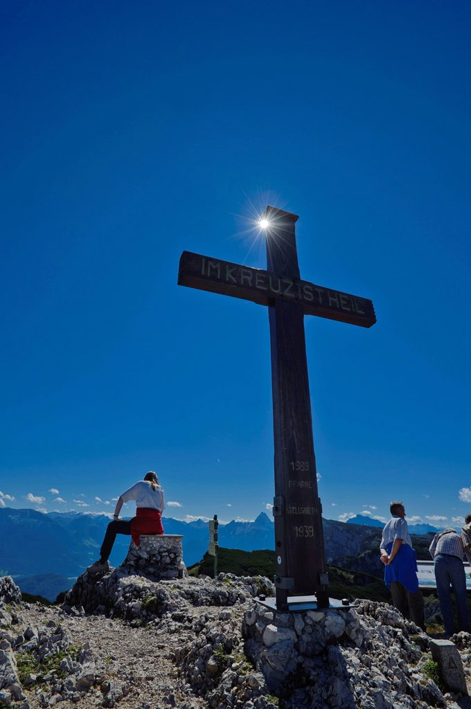 Cross on the summit of Salzburg Hochthron mountain, hiker taking a break, Untersberg, Groedig, Salzburg, Austria, Europe : Stock Photo