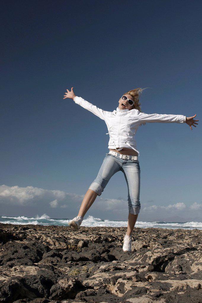 Stock Photo: 1848-678588 Carefree woman on the beach, Playa de Marfolin, Los Lagos Cotillo, Fuerteventura, Spain, Europe
