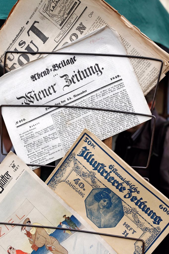Stock Photo: 1848-679997 Historical Austrian newspapers for sale, flea market, Naschmarkt market, Wienzeile street, Vienna, Austria, Europe