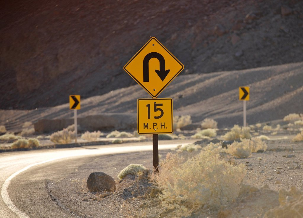 Stock Photo: 1848-680161 Sharp curve traffic sign, curvy road, Artist´s Drive, Death Valley National Park, Mojave Desert, California, United States of America, USA