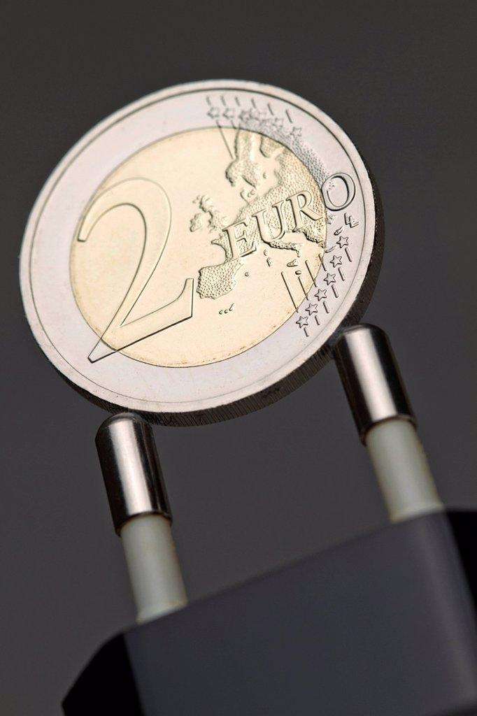 Stock Photo: 1848-680987 Two_euro_coin on a power plug, symbolic image for electricity rates