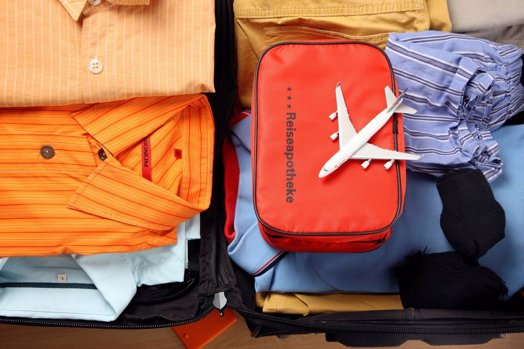 Stock Photo: 1848-681243 Holiday luggage, first_aid kit