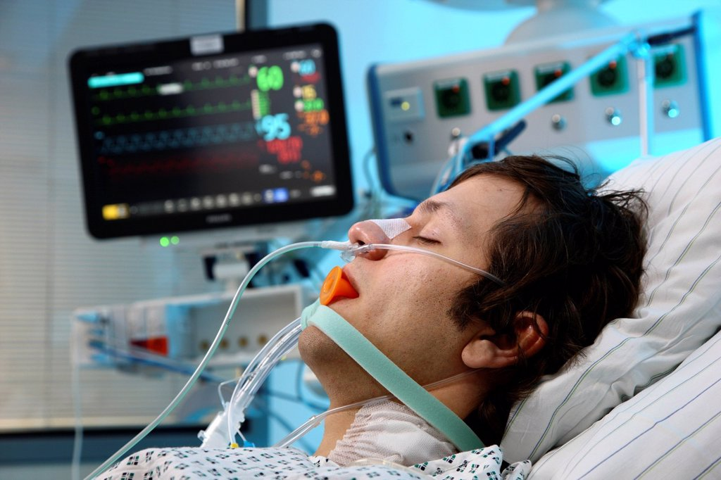 Stock Photo: 1848-682401 Patient lying in a special bed, intubated, medical appliances for medical treatment and artificial respiration of the patient, automatic monitoring of vital functions, intensive care unit, hospital
