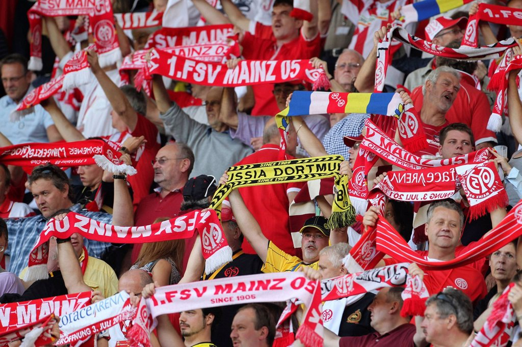 Stock Photo: 1848-682692 Fan of Borussia Dortmund amidst fans of FSV Mainz 05, football Bundesliga, match between FSV Mainz 05 and Borussia Dortmund, Coface_Arena, Mainz, Rhineland_Palatinate, Germany, Europe