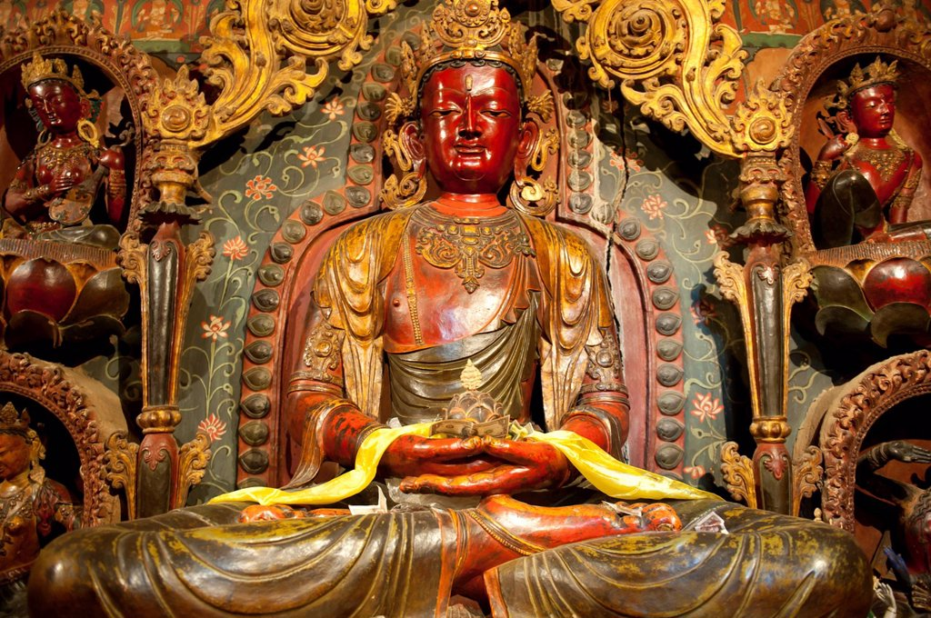 Tibetan Buddhism, Newari_style sculptures, colourfully painted statues made of wood and clay, red Buddha statue, Palcho Monastery, also known as Pelkor Chode Monastery, Gyantse, Himalaya Range, Tibet Autonomous Region, People´s Republic of China, Asia : Stock Photo