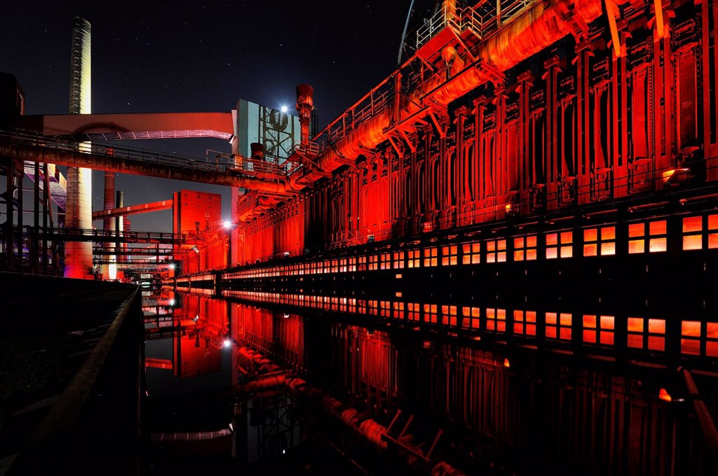 Industrial buildings illuminated at night, Zeche Zollverein Coal Mine, Essen, North Rhine_Westphalia, Germany, Europe : Stock Photo