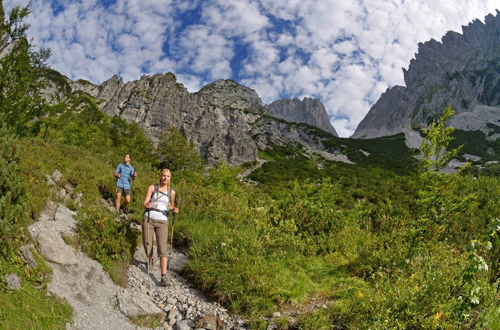 Stock Photo: 1848-683401 Hikers descending from Gruttenhuette mountain lodge, Karlspitze mountain, Ellmauer Tor mountain ridge, Wilder Kaiser mountain, Tyrol, Austria, Europe