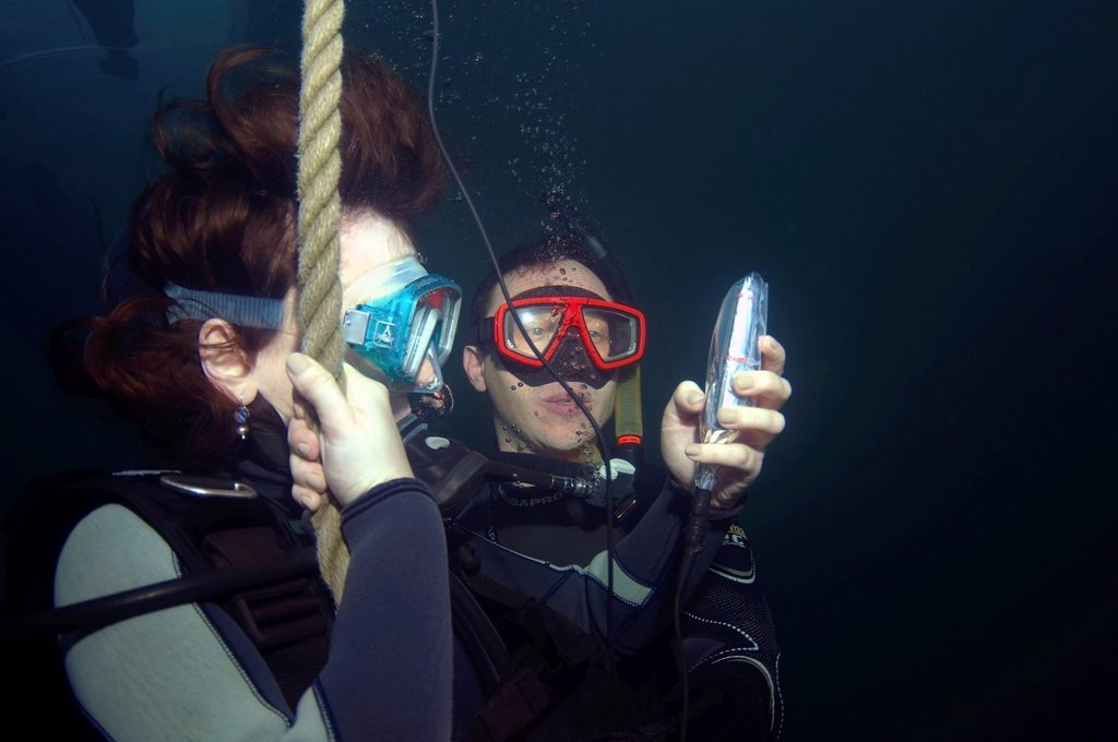 Stock Photo: 1848-684818 Girl sending SMS with mobile phone, under water, dolphinarium, Odessa, Ukraine, Europe