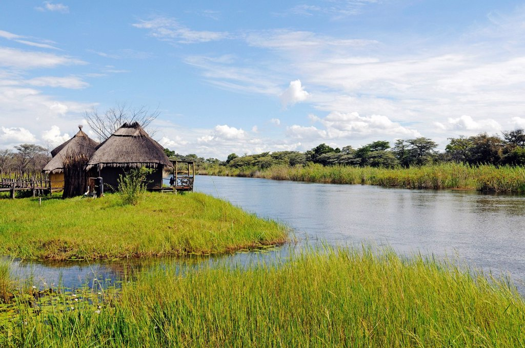 Chalets in Camp Kwando, lodge and campground on the Kwando River, Caprivi Strip or Okavango Strip, Namibia, Africa : Stock Photo