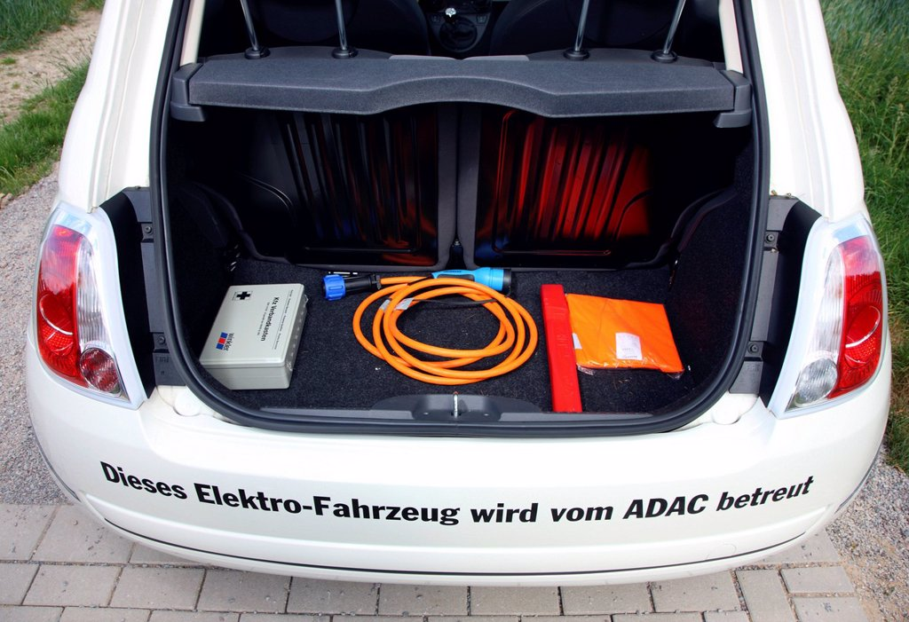 Charging cable in the trunk, electric car of the Emscher Lippe Energie GmbH, ELE, type Fiat 500, North Rhine_Westphalia, Germany, Europe : Stock Photo