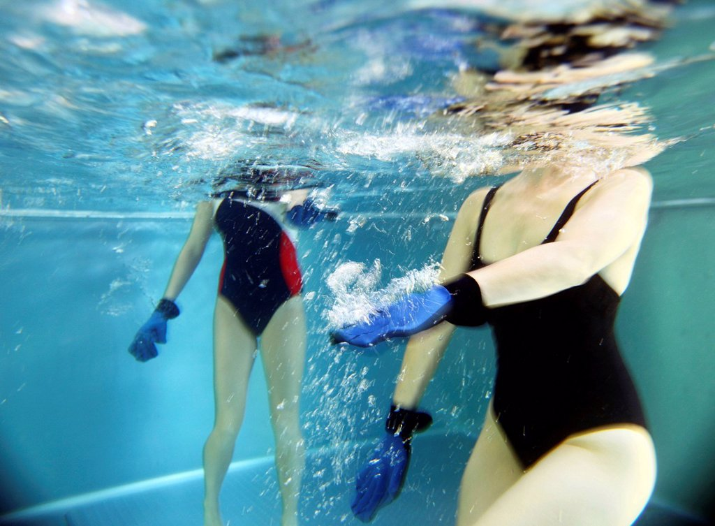 Stock Photo: 1848-686921 Patients doing aqua aerobics, water aerobics, exercise therapy, physiotherapy in water, e.g. as a rehabilitation program, in a hospital in Germany, Europe