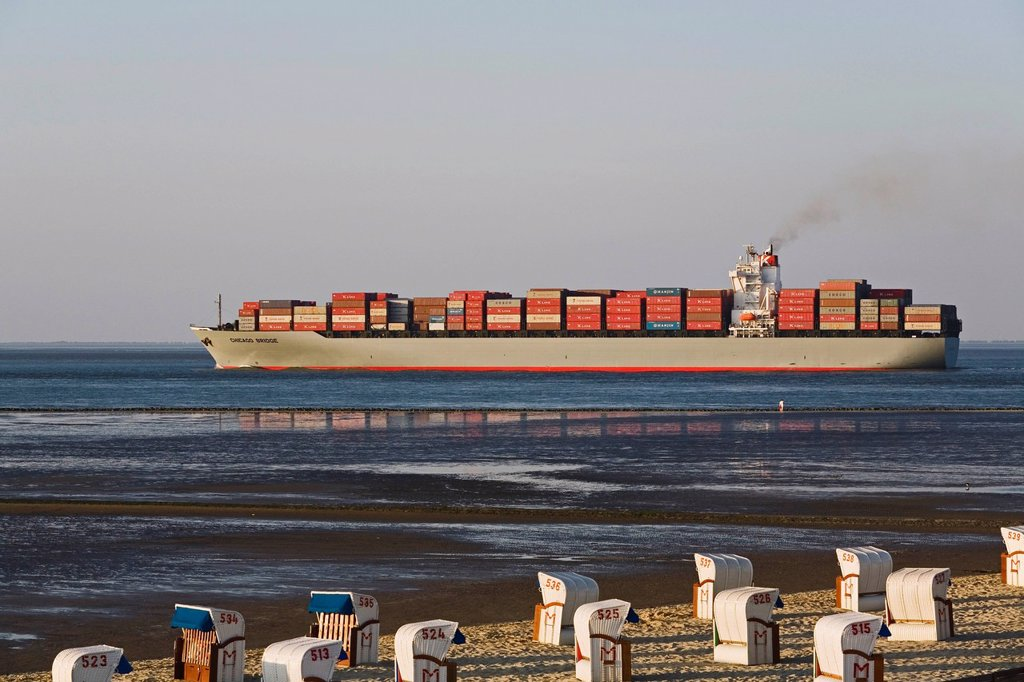 Stock Photo: 1848-687009 Container ship in the Wadden Sea, roofed wicker beach chairs, Cuxhaven, Lower Saxony, Germany, Europe