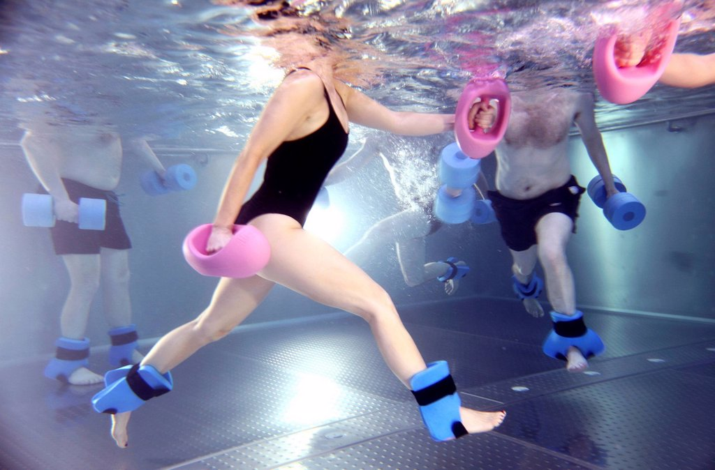 Stock Photo: 1848-687496 Patients doing aqua aerobics, water aerobics, exercise therapy, physiotherapy in water, e.g. as a rehabilitation program, in a hospital in Germany, Europe