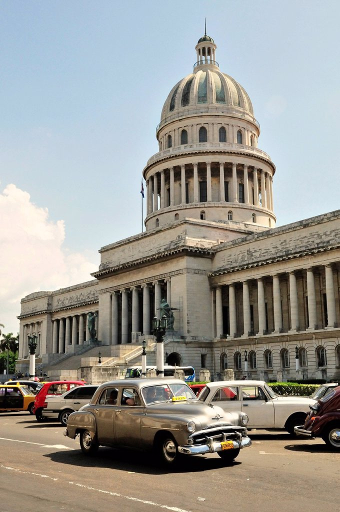 Vintage car in front of El Capitolio or National Capitol Building, home of the Cuban Academy of Sciences, Havana, Cuba, Caribbean : Stock Photo