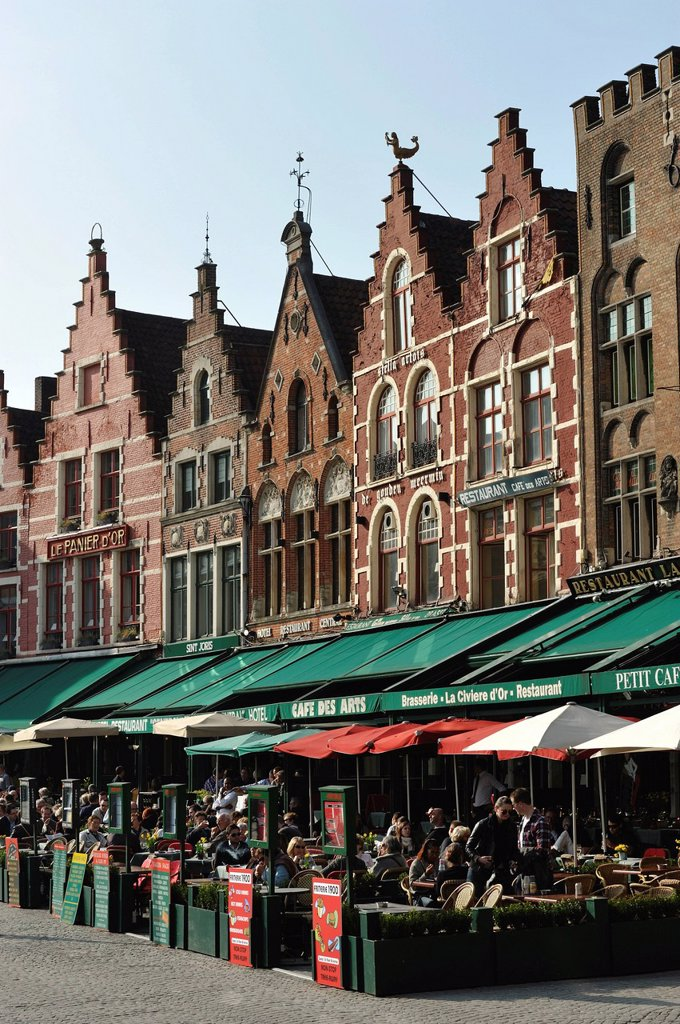 Restaurant terraces on the market square of Bruges, Flanders, Belgium, Europe : Stock Photo
